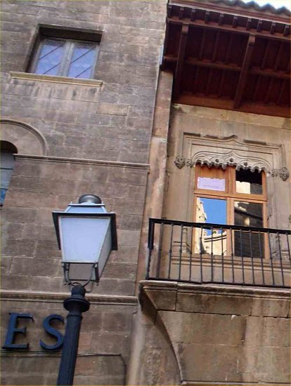 maiorca spain lamppost window reflection old stone