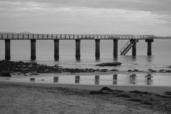 blackandwhite pier murrays bay reflection
