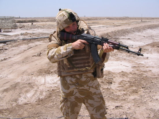 Pte Compton poses with an OPF guards AK.  This to be filed under 'one to impress the girlfriend'!