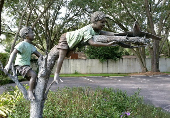 statue tree airplane boys