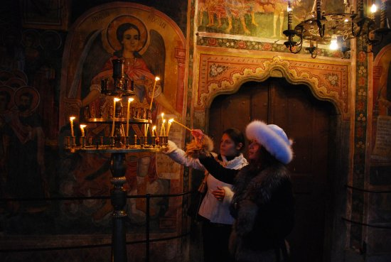 church monastery christianity candles girls Bulgaria Troyan nikon