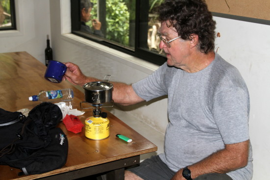 My brother-in-law Peter putting the primus on at Atiwhakitu Hut, Tararua Ranges for a cup of tea ...