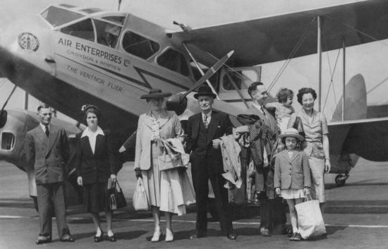 bw old family pic uncle aunt aeroplane flying