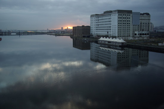 london docklands royal victoria docks water sunrise dawn old building ripples