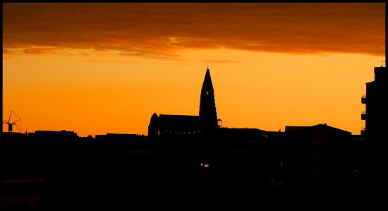 sun sunset church iceland city architecture building skyline