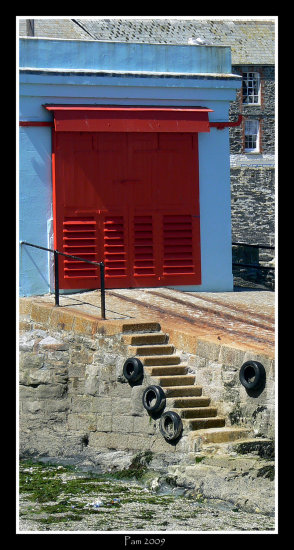 red blue lifeboat house mevagissey sea coast cornwall