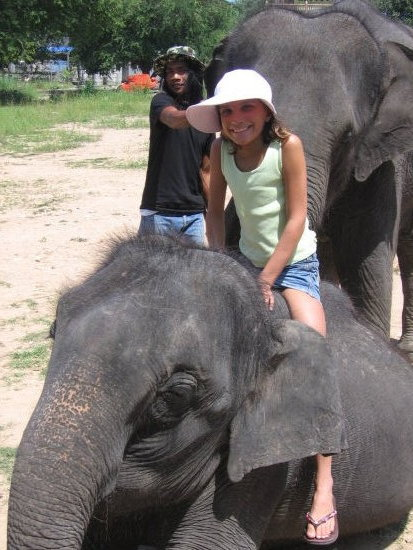 Me sitting on the baby elephant's back.
