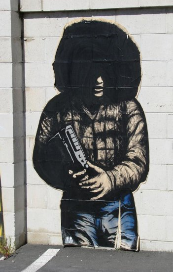 This piece of garaffiti is about 2 metres, (over 6ft), tall and is on paper and stuck to the wall.