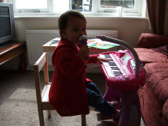 Izzy playing her new piano and singing