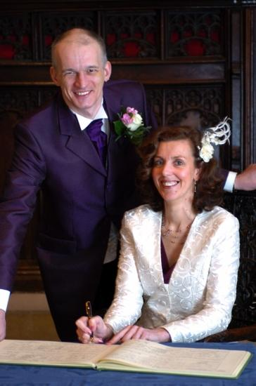 After the ceremony - signing the register. I practice my gameshow pose.