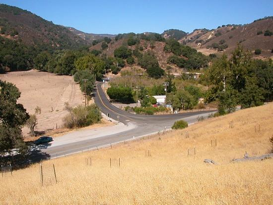 The San Andreas fault runs up this little valley west of Hollister, on Cienega Road. The hills ar...