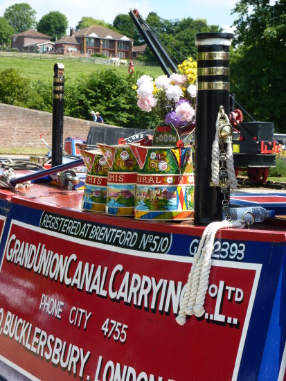 narrowboat water cans buckby cans canal colourful ropework traditional