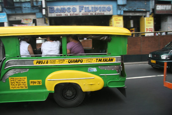 jeepney 4/4  lovely going around manila, this is near quiapo.