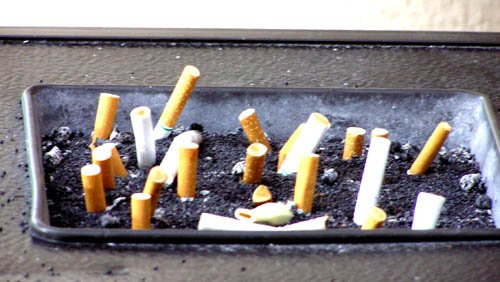 ashes cigarettes smokes cancer foul filters deception corporate greed