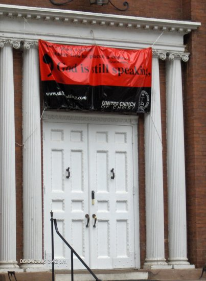 United Church on the Green ~ Banner hanging over center church doors.