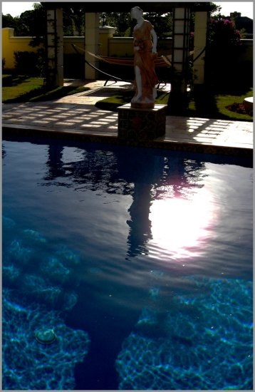 pool water shadow statue reflection surreal abstract transcendence