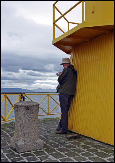 ander reykjavik iceland sea yellow lighthouse photographer pier man