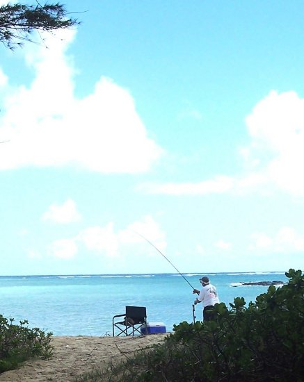 We had a nearby fisherman who caught a fish while we were there.