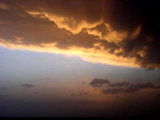 Storm Clouds above the setting sun.