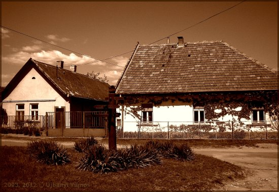 rural house roof fence bush tree sky clouds sepia
