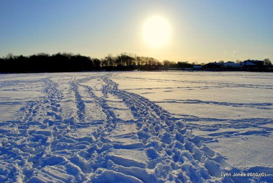 snow sun footsteps