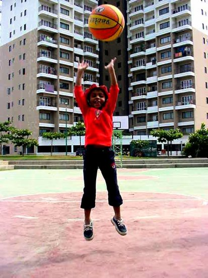 jumping for the basket ball
