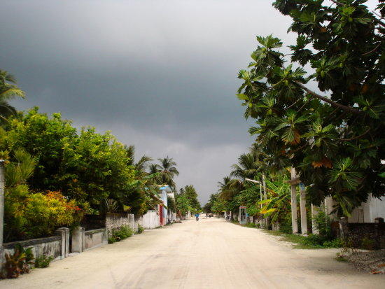 dark clouds island road maldives