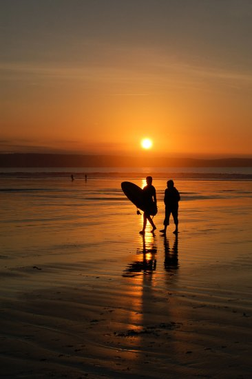 westward ho surfers sunset north devon landscape