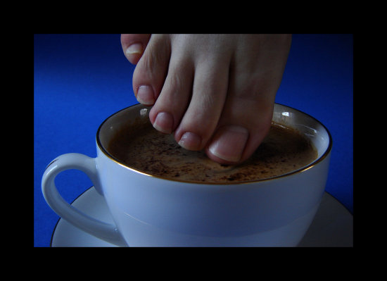 coffee cupandsaucer foot toes hot burn toenails calciumdeficiency ouch
