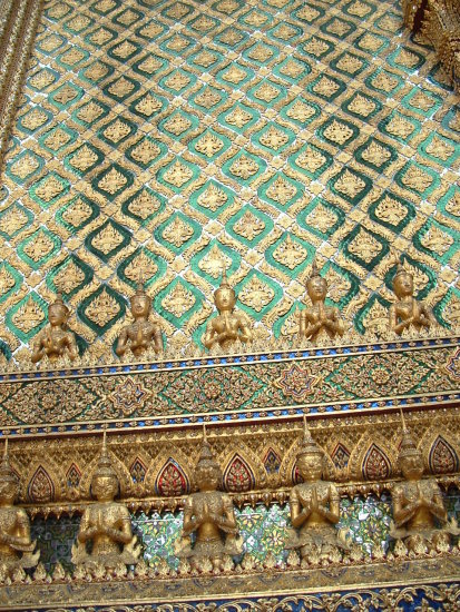 Gold and jade adorn the walls at Wat Phrakaew Temple in Bangkok Thailand