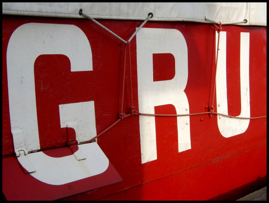red ship letters g r u abstract read
