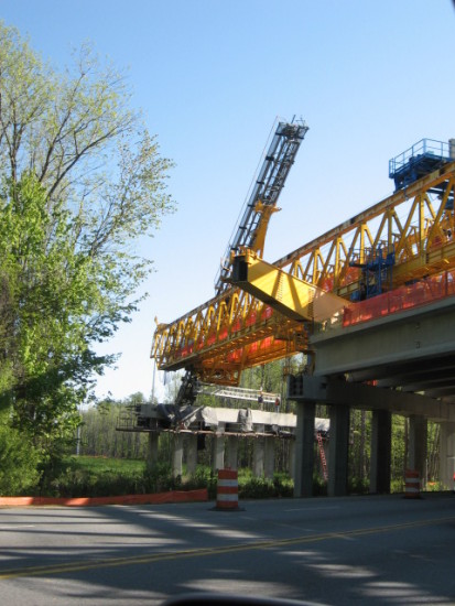road overpass and road construction in progress - lowering of the pile driver