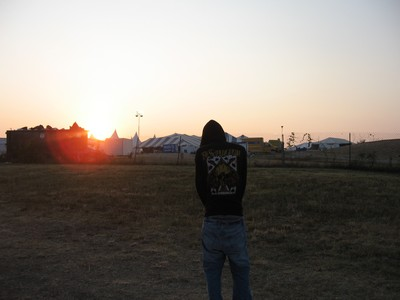 This is my friend mark standing before a sunrise it was the last day of ichthus we styaed up all ...