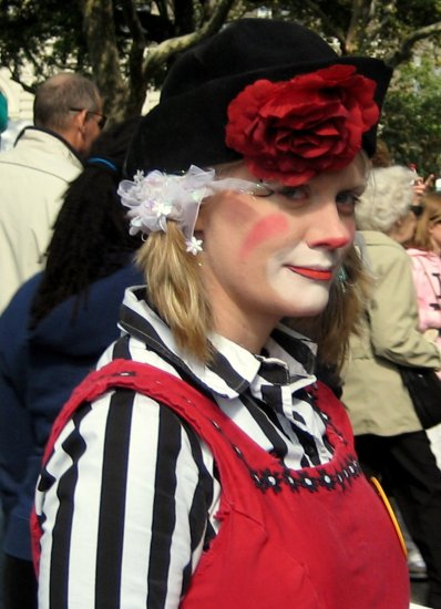 clown costume circus red nose make up humor profile candid shot