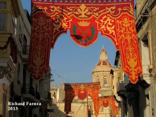 The Village Feast  A street in Luqa, Malta decorated for the feast of Saint Andrew with the dom...