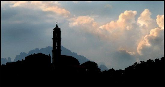 silhouette clouds dramatic landscape corsica village perspective mountains