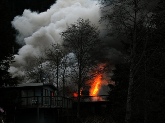 house across the street from mine burned today...the firemen fought it in freezing weather.