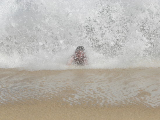 My son on vacation catching the waves. I love the way this picture captured the water.