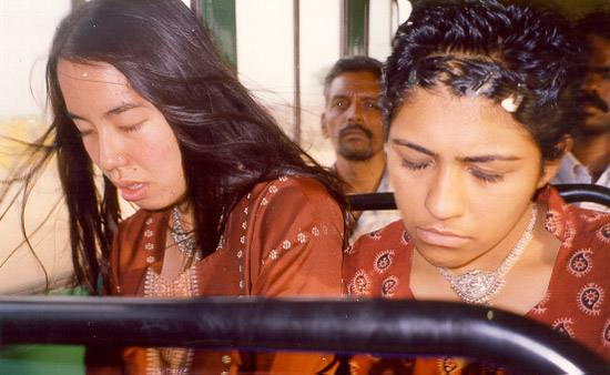 June and Shayna dozing on a bus in Hyderabad India 2000