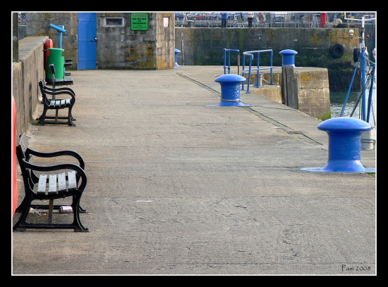 bench blue quay harbour padstow cornwall
