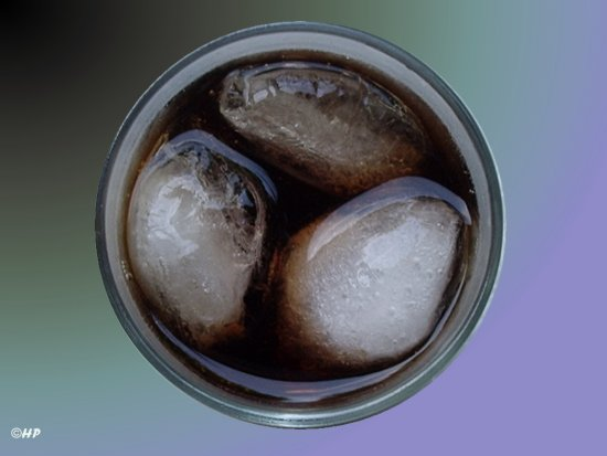 A glass Coca Cola with ice