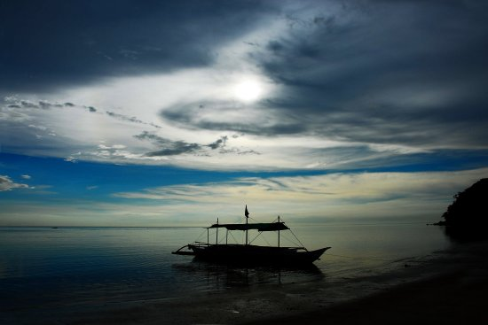 lonely boat sea beach water philippines copyright