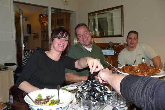 cosy eating mussels with family