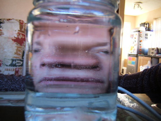My face through a Jam Jar ignore the tatty ironing board cover behind me