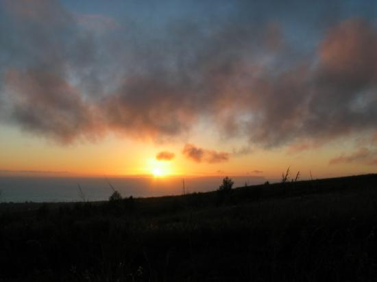 Sunset over Ni'ihau Island, Hawai'i. Taken from the Waimea Canyon road 1/23/05.