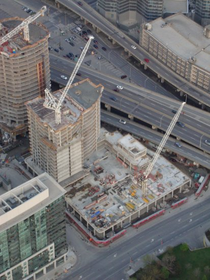 At 8:10pm-I'm up in the CN Tower-to lots of construction all over-looking down over on the Lakesh...