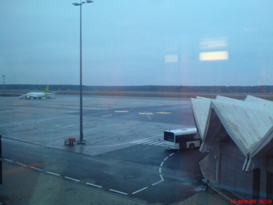 Rigaairport riga airport airBaltic raining
