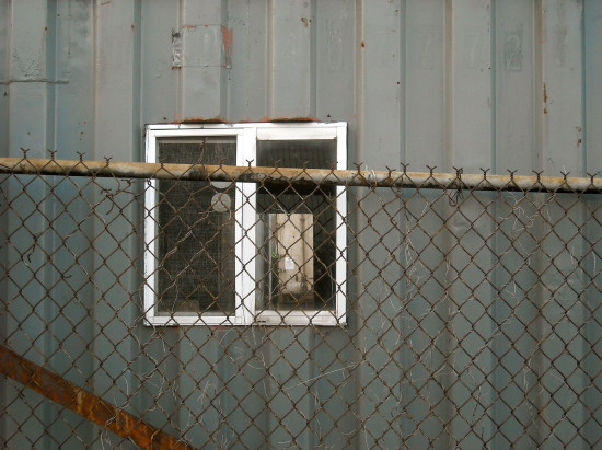 grey wall industry chainlink fence window