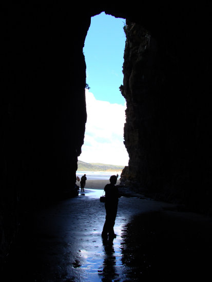 Liz silhouetted Cathedral Caves South Otago New Zealand littleollie
