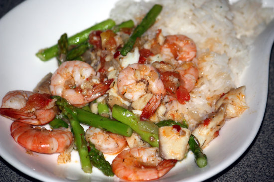 Seafood and asparagus. The prawns were fresh (in fact they were literally jumping around the kitc...
